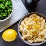 Lemon Ricotta Pasta and Green Beans in Bowls on a table
